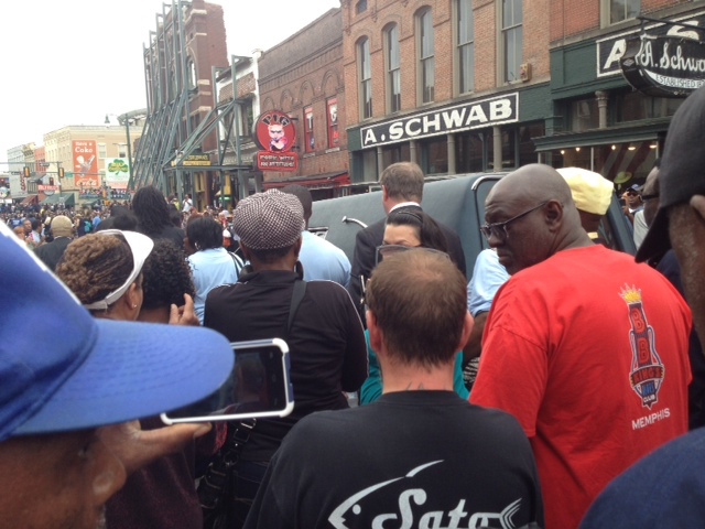 A hearse bearing the body of blues great B.B. King passes the famous A. Schwab store on Beale Street in Memphis. Throngs turned out with happy memories of the beloved musician. The cortege traveled to Indianola in the Mississippi Delta, near King's birthplace and the site of his burial.