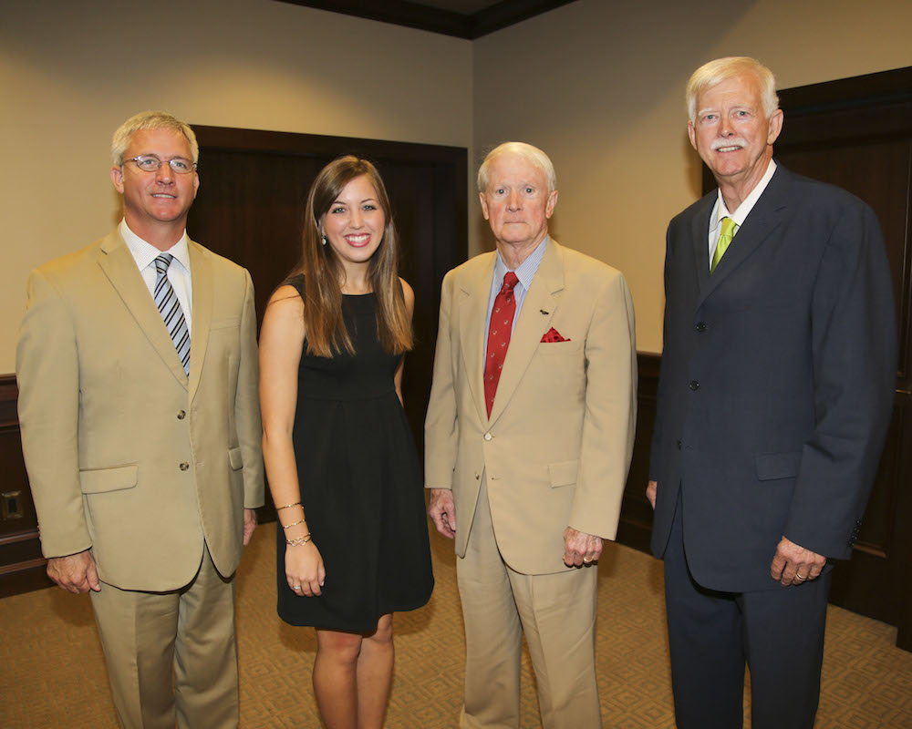 Pictured from left: Transportation Commissioner Mike Tagert; Clancy Smith; Transportation Commissioner Dick Hall; and, Transportation Commissioner Tom King.