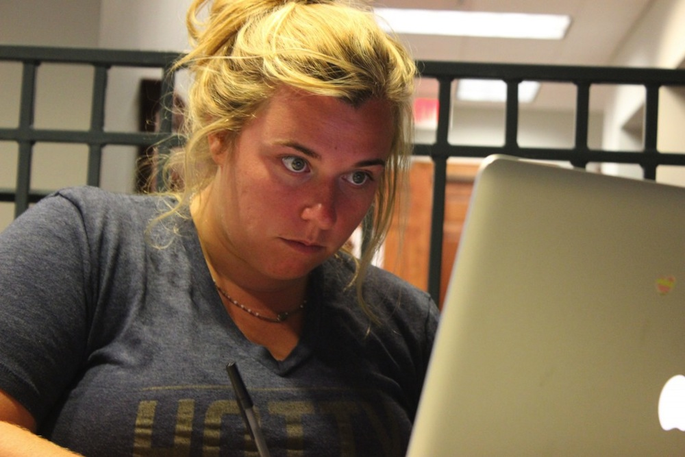 Rebecca Fabick is a senior studying Integrated Marketing Communication. Fabick is studying her notes before class.