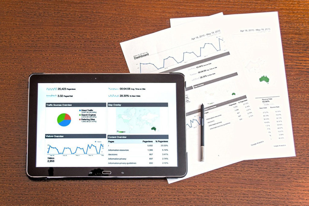 An ipad showing data analytics and papers