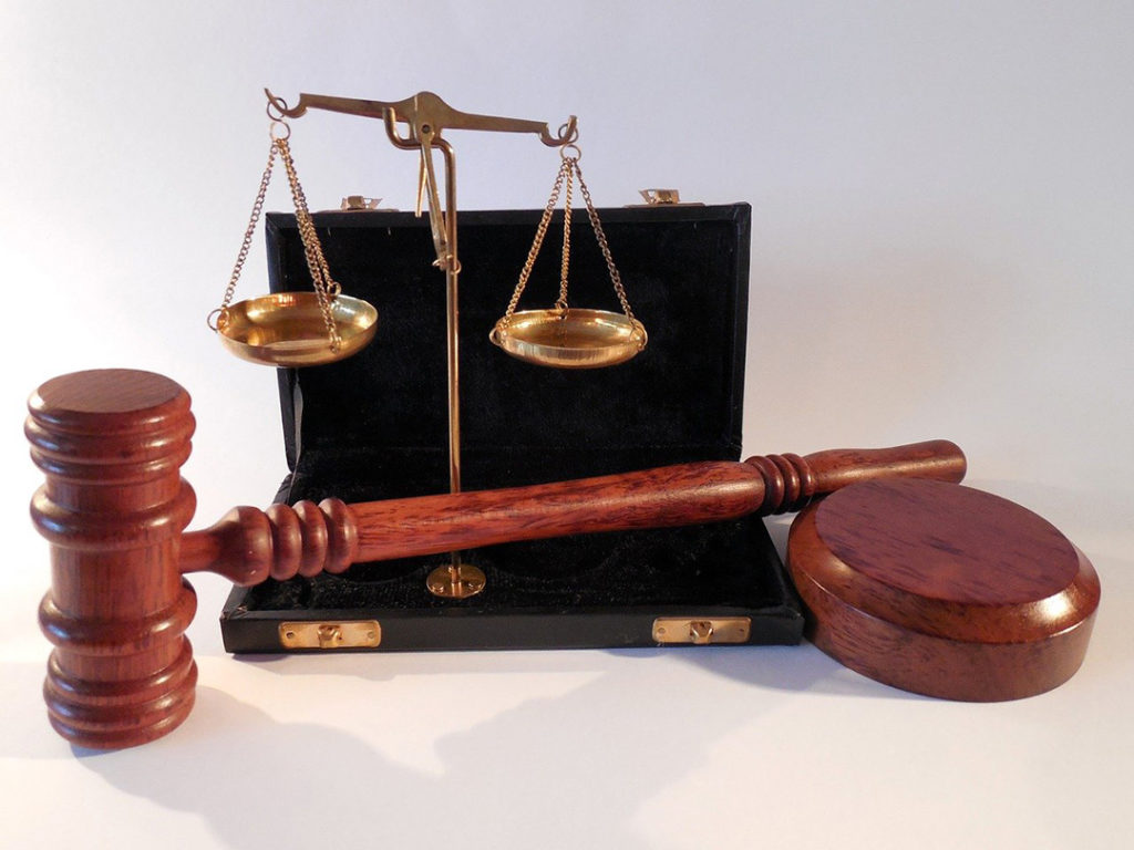 A gavel and weights that symbolize law.