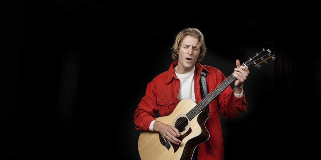 Matthew Hendley playing guitar.