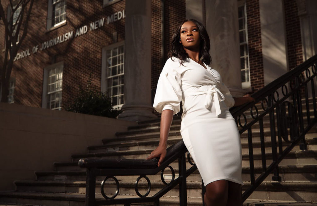 Eumetria Jones in front of Farley Hall
